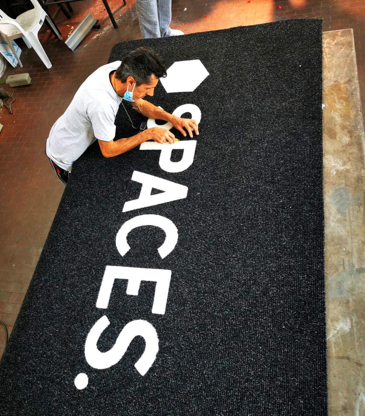 Branding e pellicole - tappeto Spaces