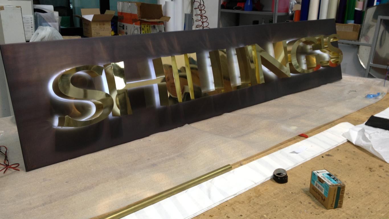 Insegna - Shilling's